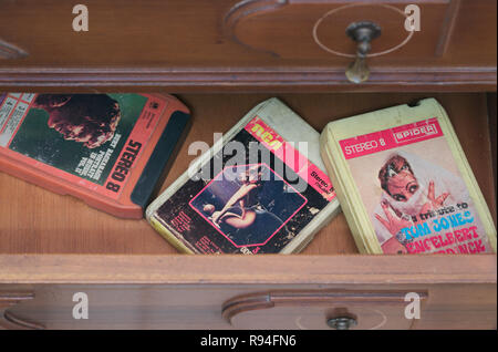 8-track stereo music cassettes from the 1970's in a drawer - Stock Photo