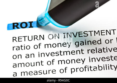 Dictionary definition of ROI Return On Investment highlighted with blue text marker. - Stock Photo