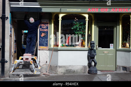 UK High street shoppers shopping and visitors browsing shop fronts - Stock Photo