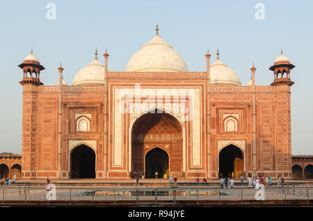 Red sandstone mosque at the Taj Mahal complex, Agra, Rajasthan, India - Stock Photo