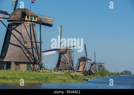 Famous Windmills beside canals at the Unesco World Site of Kinderdijk, South Holland, The Netherlands - Stock Photo