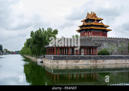 Corner tower and pavilion of The Forbidden City (north east corner) showing reflections in the surrounding tongzi river, Beijing, China - Stock Photo