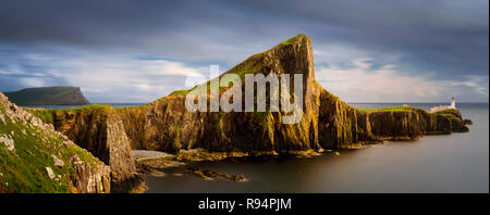 Panorama of Neist Point peninsula with white lighthouse, Isle of Skye, Scotland - Stock Photo