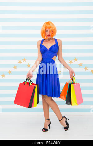 shopping. Attractive girl is crazy about shopping. Delighted woman shopping online. Woman going to make payment in supermarket. Thanks for your purchase. Pleasant shopping. Choosing the best. - Stock Photo