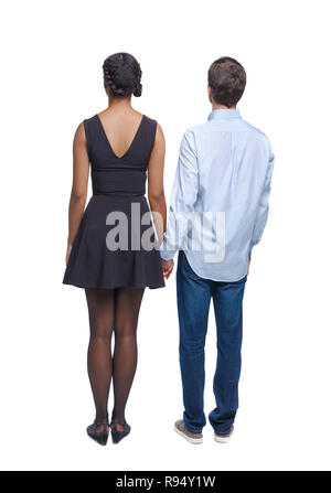 Back view of the interracial couple. beautiful friendly girl and guy together. Rear view people collection. backside view of person. Isolated over whi - Stock Photo