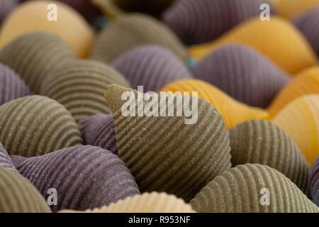 Closeup of vegetable pasta shells - Conchiglie Rigate - Stock Photo