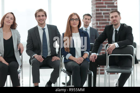Business people sitting in the waiting room - Stock Photo