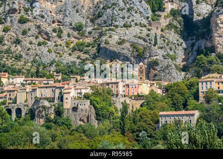 View over the Notre-Dame-de-l'Assomption church and the village Moustiers-Sainte-Marie, Alpes-de-Haute-Provence, Provence-Alpes-Côte d'Azur, France - Stock Photo