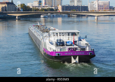 Basel, Switzerland - October 31, 2014: the Rhine river and industrial buildings, Marie-Louise vessel pasing along the river. Basel is a city on the Rh - Stock Photo