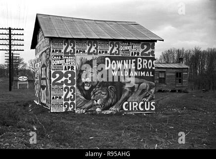 Posters covering a building near Lynchburg to advertise a Downie Bros. circus. Photograph by Walker Evans /FSA (1903-1975) - Stock Photo