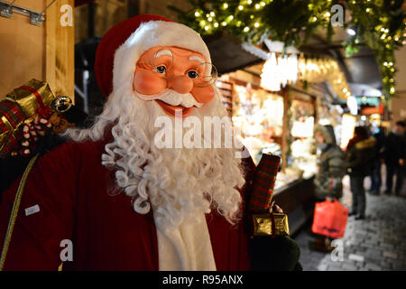 A life-size mannequin of Santa Claus for sale at the Christmas market in Leipzig, Saxony, Germany. - Stock Photo