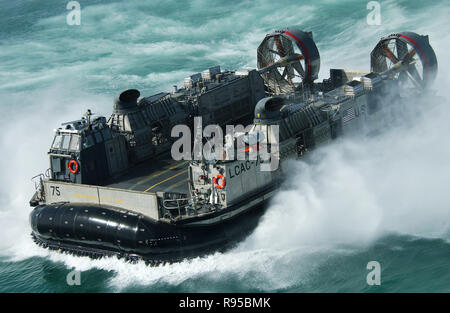 A U.S. Navy Landing Craft Air Cushion- LCAC - kicks up spray as it heads to the Kuwait Naval Base from the amphibious dock landing ship USS Harpers Ferry (LSD 49). DoD photo by Petty Officer 1st Class Richard J. Brunson, U.S. Navy. - Stock Photo
