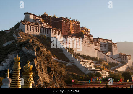 Potala Palace at sunrise, Lhasa, Tibet, China, the seat of the Dalai Lama's theocratic government before the Chinese invasion - Stock Photo