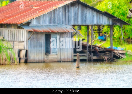 This unique image shows an abandoned haunted house at a lake in Hua Hin in Thailand - Stock Photo