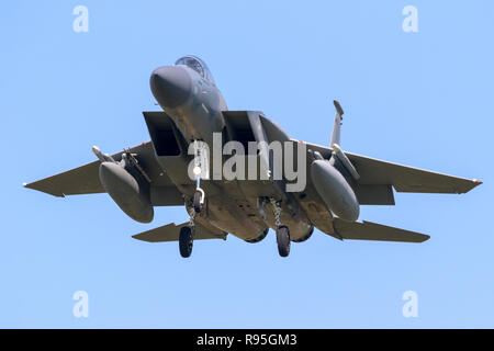 LEEUWARDEN, NETHERLANDS - APR 19, 2018: US Air Force F-15 Eagle fighter jet airplane on final approach for landing at Leeuwarden airbase during exerci - Stock Photo