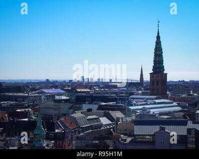 Copenhagen aeial view with the spire St. Nikolaj church and Oresund Bridge on the horizon - Stock Photo