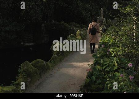 Woman in garden in portugal - Stock Photo