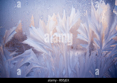 Frosty pattern on the glass. Winter Christmas abstract backdrop. Frosted glass ice background, natural beautiful snowflakes. - Stock Photo