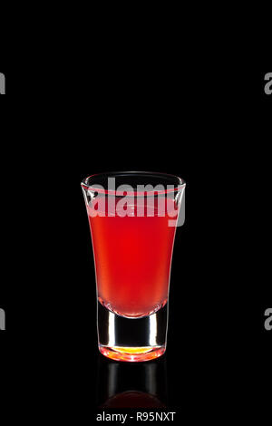 Fresh cranberry juice as ingredient for vodka cocktail isolated on black - Stock Photo