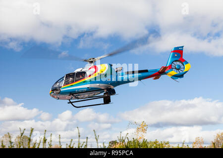 A sightseeing helicopter from Niagara Helicopters in Canada takes off to view the Falls. - Stock Photo