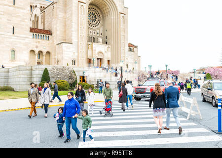 Washington DC, USA - April 1, 2018: People, family, mother, children walking by basilica of the National Shrine of the Immaculate Conception Catholic  - Stock Photo