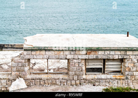 Destroyed, damaged building, shelter, home, house near Old seven mile bridge at ocean, sea shore, blue green water in Florida keys after hurricane irm - Stock Photo