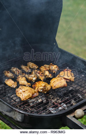 Overhead of perfectly grilled chicken on hot grill - Stock Photo