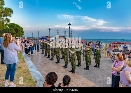 Thessaloniki, Greece - Jun 25, 2018: Greek army soldiers on the seaside, doing a demonstration with weapons in front of the public - Stock Photo