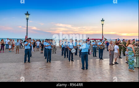 Thessaloniki, Greece - Jun 25, 2018: Greek musical famfara on the seashore, singing in the public square in front of people, celebrating opening of th - Stock Photo