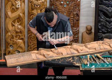 Maori carving, Whakarewarewa, Rotorua, North Island, New Zealand - Stock Photo