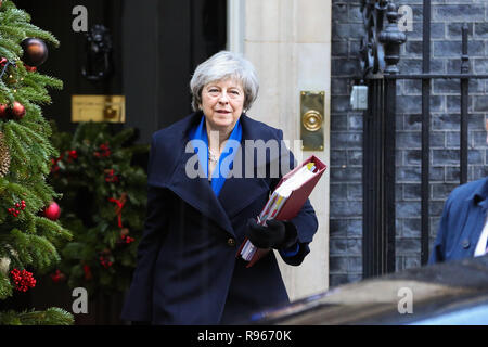 British Prime Minister Theresa May departs from Number 10 Downing Street to attend the final Prime Minister's Questions (PMQs)  of 2018 in the House of Commons with 100 day for Brexit. The United Kingdom will formally leave the European Union by 29 March 2019 and the UK Government has set aside £2 billion for a 'No Deal' Brexit. - Stock Photo
