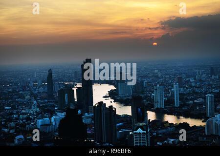 Sunset over the Chao Phraya River with beautiful city views of Bangkok.