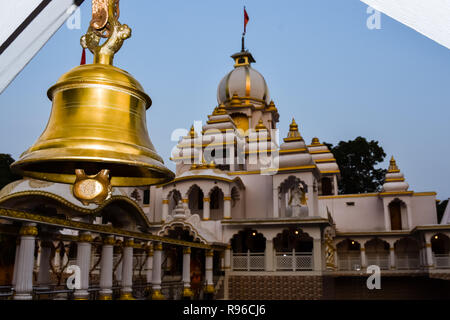 Ring bells in temple. Golden metal bell isolated. Big brass Buddhist bell of Japanese temple. Ringing bell in temple is belief auspicious. Bangkok, Th