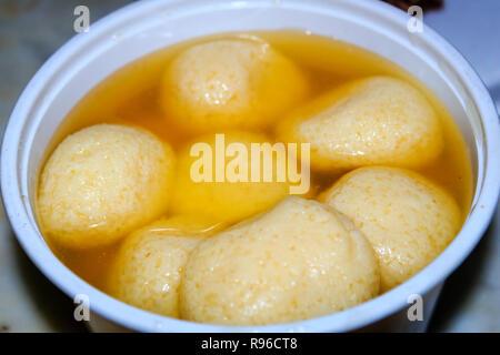 close up a bowl of indian Rasgulla dessert. Rasgulla, Indian Sweet Food, Mithai. - Stock Photo