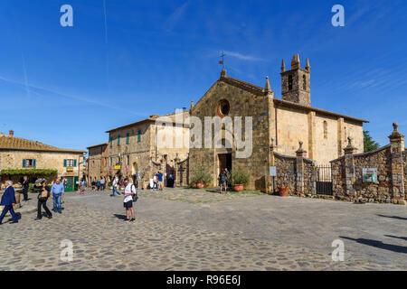 Monteriggioni, Italy - September 26, 2018: View of Rome square and Church of Santa Maria assunta. Tuscany - Stock Photo