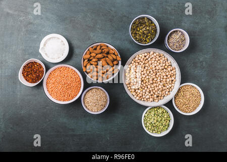Composition of different types of legumes in bowls - Stock Photo