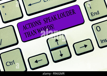 Handwriting text writing Actions Speak Louder Than Words. Concept meaning Make execute accomplish more talk less Keyboard key Intention to create comp - Stock Photo