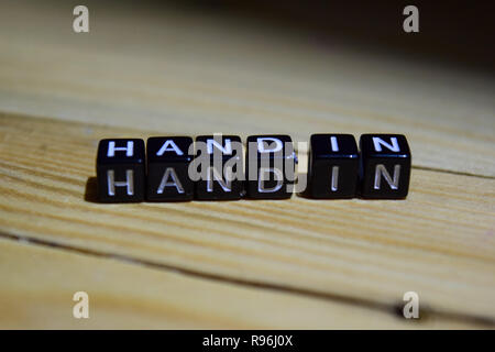 Hand in written on wooden blocks. Inspiration and motivation concepts. Cross processed image on Wooden Background - Stock Photo