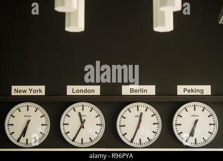 Mainz, Germany. 31st Aug, 2018. The different times of day are displayed on the clocks of the respective capitals. The Second German Television (ZDF) is one of the largest public broadcasters in Europe with its headquarters in Mainz, the capital of Rhineland-Palatinate. Credit: Andreas Arnold/dpa/Alamy Live News - Stock Photo