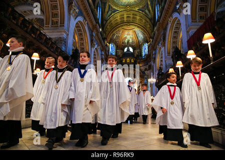 Choristers are seen rehearsing Christmas favourites at St Paul's Cathedral in London. In December, the Choristers of St Paul's will sing to more than 20,000 people across a series of services and concerts. It is estimated that on the 23rd, 24th and 25th of December alone, more than 10,000 people will come through the doors of St Paul's for Christmas services. - Stock Photo