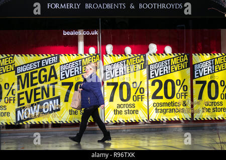 Southport, Merseyside, UK. 20th Dec, 2018. Wet & windy day for Beales Christmas shoppers as the Biggest Mega event ever sale signs go up in Beales retail outlets discounting items across the store in an attempt to stimulate festive high street sales. Credit: MediaWorldImages/Alamy Live News - Stock Photo