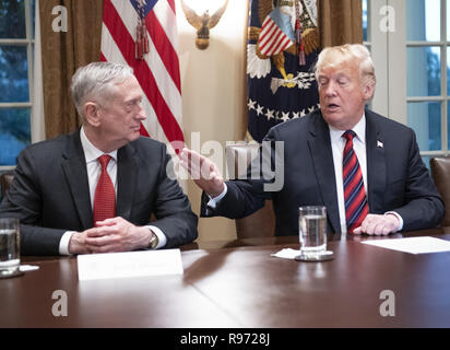 December 20, 2018: Washington, District of Columbia, U.S. - Defense Secretary Jim Mattis resigned from the Trump administration Thursday. PICTURED: October 23, 2018 - Washington, District of Columbia, U.S. - United States President DONALD J. TRUMP gestures towards US Secretary of Defense JAMES MATTIS as he makes a statement to the media as he prepares to receive a briefing from senior military leaders in the Cabinet Room of the White House. Credit: Ron Sachs/CNP/ZUMA Wire/Alamy Live News - Stock Photo