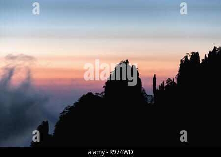 Mists in the strong winds at sunrise, Huangshan, Anhui Province, China - Stock Photo