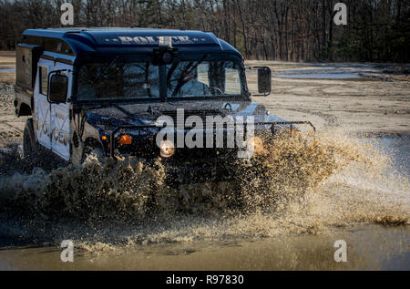 A Humvee from the Rutherford Police Department is driven on the tactical driver's course on Joint Base McGuire-Dix-Lakehurst, N.J., Dec. 18, 2018. The Humvees were acquired by local police via the Law Enforcement Support Office (LESO) program at no cost. The vehicles are used for equipment transport, high-water rescue, and inclement weather. (U.S. Air National Guard photo by Master Sgt. Matt Hecht) - Stock Photo