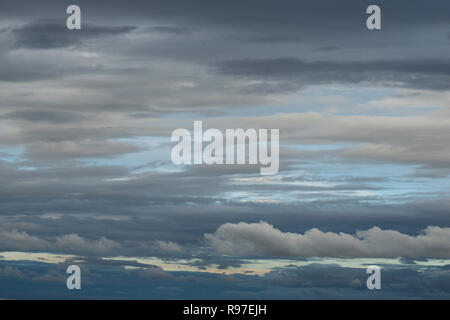 Background with grey and white clouds in the sky - Stock Photo