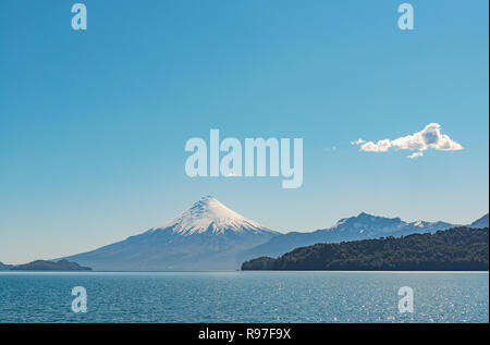 Landscape of the Osorno volcano behind All Saints Lake (Lago Todos los Santos) in the Chilean Lake District near Puerto Montt and Puerto Varas, Chile. - Stock Photo