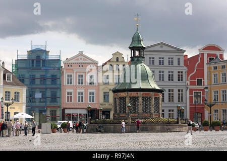 The famous waterworks at market place of Wismar in Germany, built in 1602 - Stock Photo