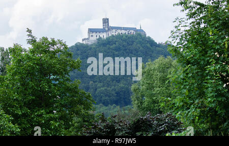 View to Bezdez Castle through trees and bushes in the surrounding nature - Stock Photo