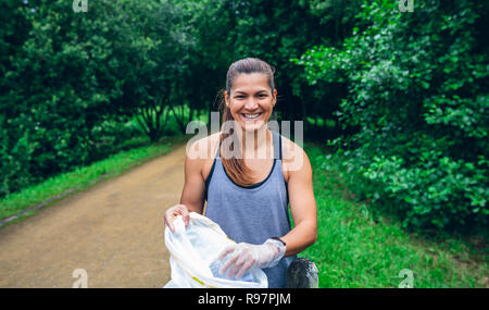 Girl with bag doing plogging - Stock Photo