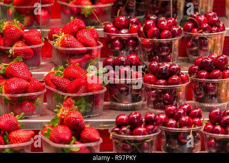 Strawberries and cherries for sale at  Mercat de Sant Josep de la Boqueria, a large public market in Barcelona, Spain. - Stock Photo